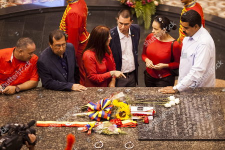 /(l-r) Chief of Venezuelan National Assembly Diosado Cabello; Elder Brother of Late President Hugo Chavez Adan Chavez First Lady Cilia Flores; Vice President Jorge Arreaza; Late President Hugo Chavez's Daughter Rosa Virginia Chavez and Current Venezuelan President Nicolas Maduro Pay Tribute Next to Hugo Chavez Tomb During an Event in Caracas Venezuela 28 July 2013 Hugo Chavez Would Have Turned 59 on This Day Venezuela Caracas