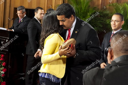 Venezuelan President Nicola Maduro (3r) Presents the National Journalist Awarad Which was Awarded Posthumously to Late Venezuelan President Hugo Chavez to Chavez' Daughter Maria Gabriela Chavez (3l) During a Ceremony at Miraflores Palace in Caracas Venezuela 27 June 2013 Chavez Died in March 2013 Venezuela Caracas