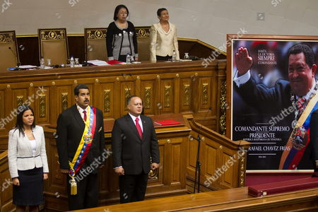 New Venezuelan President Nicolas Maduro (c) Flanked by President of National Assembly Diosdado Cabello (r) and Maria Gabriela Chavez (l) Daughter of Venezuelan Late President Hugo Chavez During His Inauguration Ceremony at National Assembly in Caracas Venezuela 19 April 2013 on the Right Speaks the President of National Assembly Diosdado Cabello Maduro was Inaugurated 19 Apil As Venezuela's President Succeeding the Late Hugo Chavez Although a Full Vote Audit was Pending the Opposition Boycotted the Inauguration Which was Attended by Many Foreign Leaders Including Presidents Dilma Rousseff of Brazil Mahmoud Ahmadinajad of Iran and Cristina Fernandez De Kirchner of Argentina Former Bus Driver and Trade Union Leader Maduro 50 Whom Chavez Designated As His Heir Less Than Three Months Before He Died March 5 of Cancer Complications is to Serve As President Until 2019 Venezuela Caracas