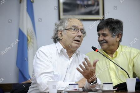 Argentinian Activist Adolfo Perez Esquivel (l) and Lawyer Carlos Slepoy (r) Attend the Hearing in the Case Against Former Spanish National Court's Civil Guard Jesus Aguilar Accused of Crimes During the Dicatorship in Spain of Francisco Franco (1939-1975) in Buenos Aires Argentina 03 April 2014 an Argentinian Judge Maria Servini De Cubria Has Been Investigating Complaints by Human Rights Lawyers in the Name of Argentinian and Spanish Victims of Killings Torture and Other Violations During Spain's 1936-39 Civil War and the Ensuing Franco Dictatorship Franco Whose Uprising Sparked the War Ruled Spain Until His Death in 1975 Servini Has Issued Arrest Warrants and Extradition Requests For Four Former Spanish Police Officers Two of Whom Are Dead Jesus Aguilar Along with Juan Antonio Gonzalez Pacheco is Charged with Committing Torture Argentina Buenos Aires