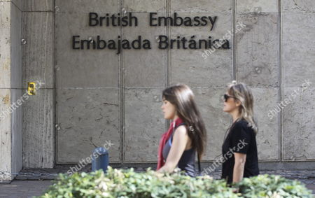 Two Women Walks in Front Ot the British Embassy in Buenos Aires Argentina 09 April 2015 the Argentinian Government Called British Ambassador in the Country John Freeman to Demand Explanations Over Alleged Espionage Against the Country Linked with the Dispute Over the Falklands and to Inform Him About Upcoming Denouncement of 'Illegal Exploitation' of Oil in the Zone Argentina Buenos Aires