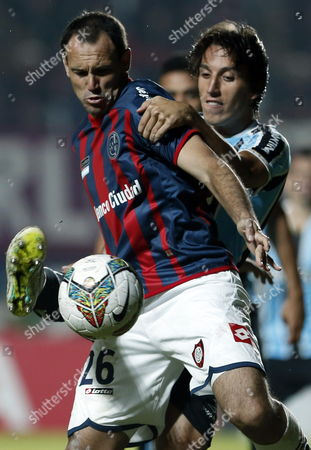 Stock Picture of Argentinean San Lorenzo Mauro Matos (l) Fights For the Ball with Brazilian Gremio's Pedro Tonon Geromel During Their Libertadores Cup Match in Buenos Aires Argentina 23 April 2014 Argentina Buenos Aires