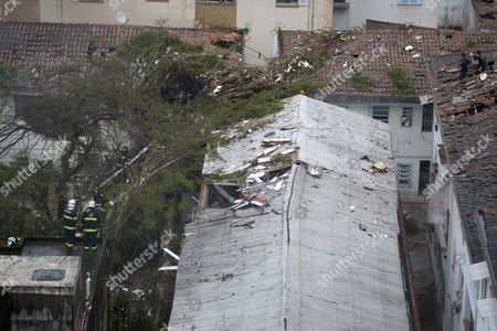 View of Damaged Buildings where an Aircraft Crashed in the Residential Area Na Rua Vahia De Abreu in Santos Sao Paulo State Brazil 13 August 2014 a Candidate in Brazil's Presidential Election was Killed on 13 August 2014 when a Small Private Plane Crashed in a Residential Area in Santos in the State of Sao Paulo Eduardo Campos 49 was the Candidate of the Brazilian Socialist Party (psb) in the 05 October Election Party Leader Carlos Siqueira Confirmed His Death to Tv Channel Globo Several People Were Reportedly Injured in the Crash Brazilian Aviation Authorities Said the Plane Had Been Carrying Seven People Brazil Santos