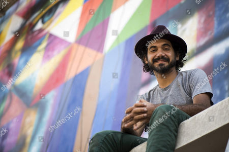 A Picture Made Available on 04 November 2014 Shows Brazilian Street Artist Eduardo Kobra Posing During an Interview As He Works on a Graffiti in Sao Paulo Brazil 31 October 2014 the Mural is Dedicated to Brazilian Musician Chico Buarque and Late Brazilian Writer Ariano Suassuna Brazil Sao Paulo