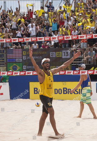 Stock Image of Brazilian Player Pedro Solberg Celebrates After Defeating with His Teammate Bruno Schmidt (not in Picture) Against Us Phil Dalhausser and Casey Jennings at the Final Match From the Fivb Beach Volleyball World Tour Grand Slam in Sao Paulo Brazil 13 October 2013 Brazil Sao Paulo