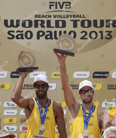 Brazilian Players Bruno Schmidt (r) and Pedro Solberg (l) Celebrate on the Podium Their Victory Against Us Phil Dalhausser and Casey Jennings at the Final Match From the Fivb Beach Volleyball World Tour Grand Slam in Sao Paulo Brazil 13 October 2013 Brazil Sao Paulo