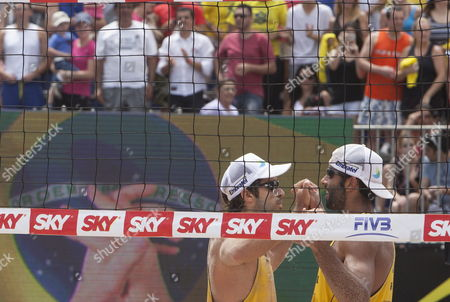 Brazilian Players Bruno Schmidt and Pedro Solberg (r) Celebrate Their Victory Against Us Phil Dalhausser and Casey Jennings at the Final Match From the Fivb Beach Volleyball World Tour Grand Slam in Sao Paulo Brazil 13 October 2013 Brazil Sao Paulo