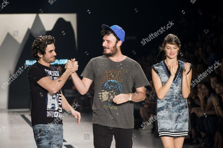 (l-r) Brazilian Singer and Actor Fiuk Designer Thiago Marcon and Brazilian Actress and Model Laura Neiva Take to the Catwalk After the Thiago Marcon Show During the Sao Paulo Fashion Week Collection Winter 2015 in Sao Paulo Brazil 07 November 2014 Brazil Sao Paulo
