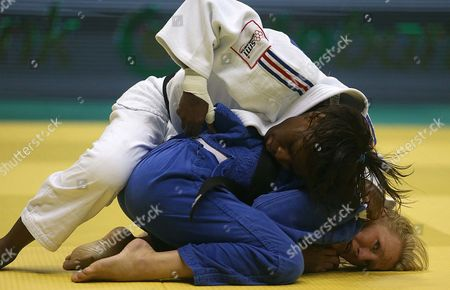 Miranda Wolfslag (bottom) of the Netherlands Fights with France's Priscilla Gneto in the Women's -52 Kg Category at the 2013 World Judo Championships in Rio De Janeiro Brazil 27 August 2013 Brazil Rio De Janeiro