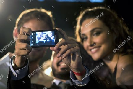 British Formula One Driver Jenson Button of Mclaren (l) and Brazilian Actress Debora Nascimento (r) Pose with a Fan For a Picture During an Event Encouraging the Use of Taxis After Drinking Alcohol in Sao Paulo Brazil 06 November 2014 Brazil Sao Paulo