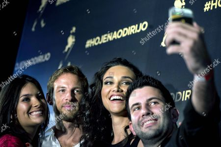 British Formula One Driver Jenson Button of Mclaren (2-l) and Brazilian Actress Debora Nascimento (2-r) Take a Slefie with Fans During an Event Encouraging the Use of Taxis After Drinking Alcohol in Sao Paulo Brazil 06 November 2014 Brazil Sao Paulo