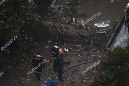 Emergency Workers Inspect Damaged Buildings where an Aircraft Crashed in the Residential Area Na Rua Vahia De Abreu in Santos Sao Paulo State Brazil 13 August 2014 a Candidate in Brazil's Presidential Election was Killed on 13 August 2014 when a Small Private Plane Crashed in a Residential Area in Santos in the State of Sao Paulo Eduardo Campos 49 was the Candidate of the Brazilian Socialist Party (psb) in the 05 October Election Party Leader Carlos Siqueira Confirmed His Death to Tv Channel Globo Several People Were Reportedly Injured in the Crash Brazilian Aviation Authorities Said the Plane Had Been Carrying Seven People Brazil Santos