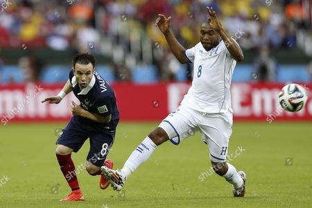 Mathieu Valbuena (l) of France in Action with Wilson Palacios of Honduras During the Fifa World Cup 2014 Group E Preliminary Round Match Between France and Honduras at the Estadio Beira-rio in Porto Alegre Brazil 15 June 2014 (restrictions Apply: Editorial Use Only not Used in Association with Any Commercial Entity - Images Must not Be Used in Any Form of Alert Service Or Push Service of Any Kind Including Via Mobile Alert Services Downloads to Mobile Devices Or Mms Messaging - Images Must Appear As Still Images and Must not Emulate Match Action Video Footage - No Alteration is Made to and No Text Or Image is Superimposed Over Any Published Image Which: (a) Intentionally Obscures Or Removes a Sponsor Identification Image; Or (b) Adds Or Overlays the Commercial Identification of Any Third Party Which is not Officially Associated with the Fifa World Cup) Brazil Porto Alegre