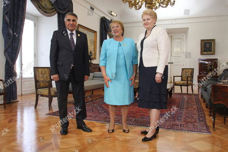 Stock Image of Chilean President Michelle Bachelet (c) Meets Her Lithuanian Counterpart Dalia Grybauskaite (r) Next to Chilean Deputy Foreign Minister Edgardo Riveros (l) at La Moneda Palace in Santiago Chile 27 February 2015 Grybauskaite is in the Country to Attend the High Level Event 'Women in Power and Decision-making: Building a Different World' Which is Being Held on 27 and 28 February Chile Santiago