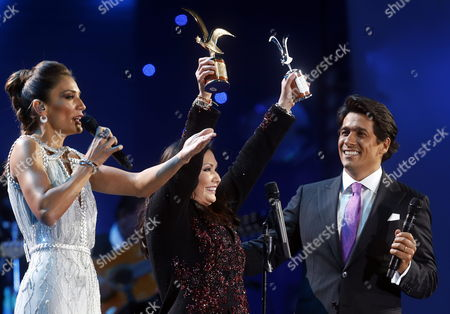 Mexican Singer Ana Gabriel (c) Receives the 'Golden Gull' (l) and the 'Silver Gull' (r) Awards After Performing During the 55th Vina Del Mar Song Festival in Vina Del Mar 120 Km From Santiago Chile 25 February 2014 the Event Runs From 23 to 28 February 2014 Chile Vina Del Mar