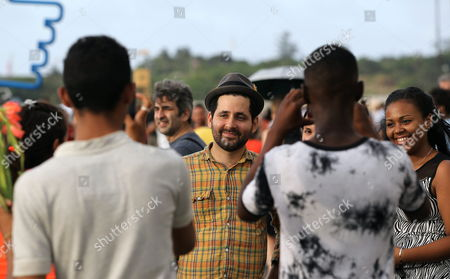 Puerto Rican Musician of the Band Calle 13 Eduardo Cabra (c) Also Known As Visitante Poses with Fans During His Visit to the 12th Edition of the Havana Art Biennial in Havana Cuba 24 May 2015 Cuba Havana