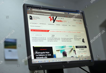 A Computer Screen Displays the Website of Independent Digital Daily '14/medio Com' Launched by Cuban Oppositional Blogger Yoani Sanchez in Havana Cuba 21 May 2014 the Website is Aimed to Report Independently Cuba Havana