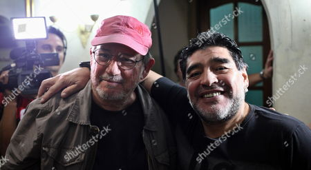 Former Soccer Player Diego Maradona (r) and Cuban Singer-songwriter Silvio Rodriguez Pose For a Photograph After a Rodriguez's Concert As Part of Maradona's Artistic Project 'Tour of Neighborhoods' in the Zamora Neighborhood of Havana Cuba 09 January 2015 Maradona Arrived in Cuba with a Team of Venezuelan Tv Channel Telesur to Film the First Two Chapters of the New Season of the Sports Program 'From Zurda' Cuba Havana