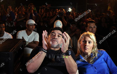 Former Argentinian Soccer Player Diego Maradona (c) and His Girlfriend Rocio Oliva (r) From Argentina As They Attend a Concert of the Cuban Singer-songwriter Silvio Rodriguez As Part of His Artistic Project 'Tour of Neighborhoods' in the Zamora Neighborhood of Havana Cuba 09 January 2015 Maradona Arrived in Cuba with a Team of Venezuelan Tv Channel Telesur to Film the First Two Chapters of the New Season of the Sports Program 'From Zurda' Cuba Havana