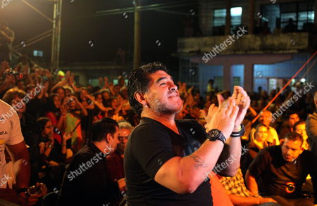 Former Argentinian Soccer Player Diego Maradona (c) Claps As He Attends a Concert of the Cuban Singer-songwriter Silvio Rodriguez As Part of His Artistic Project 'Tour of Neighborhoods' in the Zamora Neighborhood of Havana Cuba 09 January 2015 Maradona Arrived in Cuba with a Team of Venezuelan Tv Channel Telesur to Film the First Two Chapters of the New Season of the Sports Program 'From Zurda' Cuba Havana