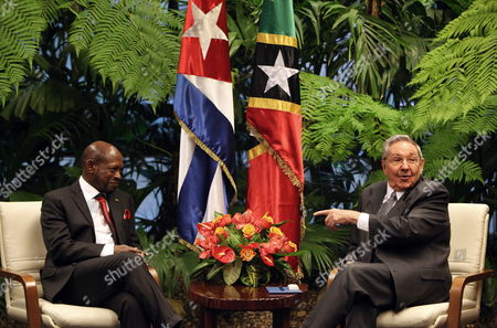 Stock Photo of Cuban President Raul Castro (r) and Prime Minister of the Federation of Saint Christopher and Nevis Denzil Llewellyn Douglas (l) During a Meeting at the Revolution Palace in Havana Cuba 24 June 2014 Cuba Havana