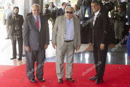 Stock Image of Ecuadorean President Rafael Correa (r) Welcomes His Counterpart From Uruguay Jos? Mujica (c) Next to the Secretary of the Union of South American Nations (unasur As It Stands in Spanish) Colombian Former President Ernesto Samper (l) Upon Their Arrival Prior to a Summit in Which the Temporary Presidency of the Unasur Will Be Transfer From Suriname to Uruguay in Guayaquil Ecuador 04 December 2014 Ecuador Guayaquil