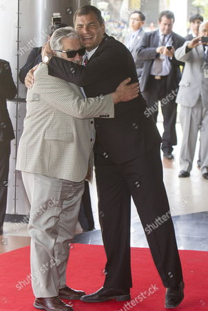 Ecuadorean President Rafael Correa (r) Welcomes His Counterpart From Uruguay Jos? Mujica (l) Upon Their Arrival Prior to a Summit in Which the Temporary Presidency of the Unasur Will Be Transfer From Suriname to Uruguay in Guayaquil Ecuador 04 December 2014 Ecuador Guayaquil