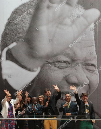 Zenani Mandela (l) Daughter of South African Late Leader Nelson Mandela Waves Next to a Giant Image of Her Father Accompanied by Participants of Forum 'Voices of Discrimination' Outside Museum of Memory and Tolerance in Mexico City Mexico 03 October 2014 in the Frame of the Exhibition 'The Legacy of Mandela 20 Years of Freedom in South Africa' Which Will Be Open Until Next 12 January 2015 Mexico Mexico City