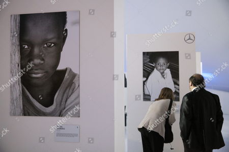 A Picture Made Available on 21 May 2015 Shows Visitors Looking at Photographs Displayed at the Exhibition by Mexican Photographer Genoveva Casanova Former Wife of Spanish Cayetano Martinez De Irujo Son of Late Duchess of Alba at Soumaya Museum in Mexico City Mexico 20 May 2015 Casanova Has Taken Photograph During the Last Decade Through Her Humanitarian Work at India Senegal Nepal Kenya and Colombia Mexico Ciudad De Mexico