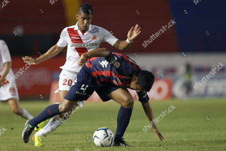 Morelia Soccer Team Player Santiago Téllez and Hector Mancilla (r) Fights For the Ball Against Atlante's Luis Venegas (r) During Their Apertura Tournament 2013 Match in Cancun Mexico 07 September 2013 Mexico Cancún