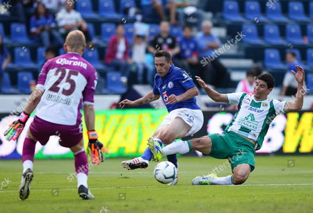 Stock Image of Cruz Azul's Christian Gimenez (c) Vies For the Ball Against Jonny Magallon (r) From Club Leon During a Match of the Mexican Apertura Tournament at the Azul Stadium in Mexico City Mexico 28 September 2013 Mexico Ciudad De México