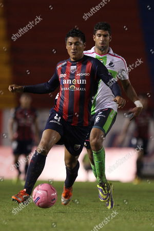 Luis Venegas (front) From Atlante Vies For the Ball with Eduardo Herrera (back) From Santos During Their Match of the Apertura Tournament 2013 Held at the Olympic Stadium in the City of Cancun Mexico 26 October 2013 Mexico Canc·n
