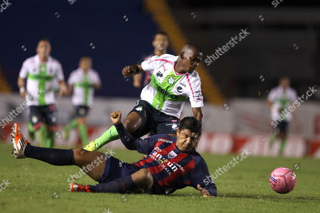 Luis Venegas (below) From Atlante Vies For the Ball with Carlos Quintero (above) From Santos During Their Match of the Apertura Tournament 2013 Held at the Olympic Stadium in the City of Cancun Mexico 26 October 2013 Mexico Canc·n