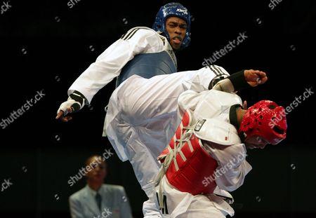 Cuban Rafael Alba (l) Fights Against Jamaican Craig Brown (r) in Their Taekwondo Combat For the 83kg at the Central America and Caribbean Games in Veracruz Mexico 17 November 2014 Mexico Veracruz