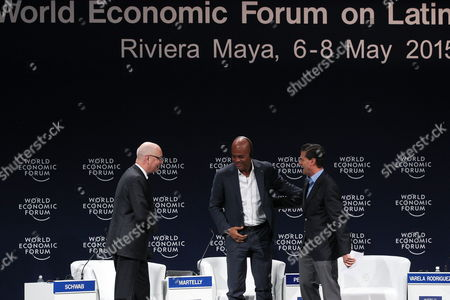 (l-r) Founder and Ceo of World Economic Forum Klaus Schwab Haitian President Michel Joseph Martelly and Mexican President Enrique Pena Nieto Participate in the Opening Session of 10th Edition of Latin American World Economic Forum in Riviera Maya Mexico 07 May 2015 Mexico Riviera Maya