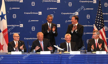 Panama's President Juan Carlos Varela (cr) and Us President Barack Obama (cl) Pose Next to From Left to Right Ceo of Ge Aviation David Joice; Ceo of Boeing James Mcnerney; Copa Airlines President Stanley Motta Ceo of Copa Airlines Pedro Heilbron During a Signing Act in Panama City on 10 April 2015 the Leaders Present Following Their Bilateral Meeting an Agreement of 6 600 Million Dollars on the Panamanian Airline Copa to Buy Manufacturer Boeing a Total of 61 Boeing Aircraft Obama and Varela Will Be Take Part in the Americas Summit Held This Friday and Saturday Panama Panam?