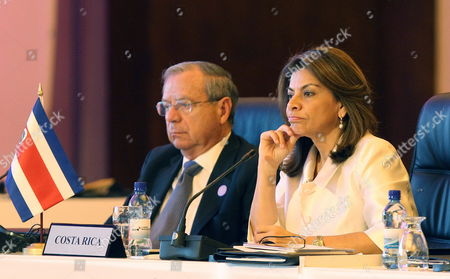 Costa Rican President Laura Chinchilla (r) and Her Foreign Minister Enrique Castillo (l) Participate in the Presidents Plenary Session at the 23th Latin American Summit in Panama City Panama 19 October 2013 Panama Panama City