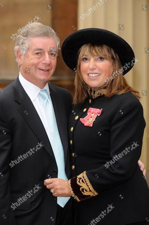 Eve Pollard, (Lady Lloyd) with her OBE for services to the Journalism and Broadcasting, accompanied by her husband Nicholas Lloyd