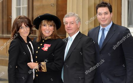 Eve Pollard, (Lady Lloyd) with her OBE for services to the Journalism and Broadcasting, accompanied by her husband Nicholas Lloyd, daughter Claudia Winkleman and son Oliver