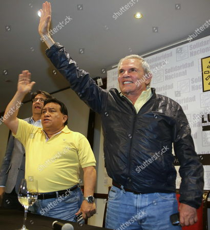 Candidate Luis Castaneda Lossio (r) Waves During a Press Conference After Results From Regional Elections Were Released in Lima Peru 05 October 2014 Castaneda Lossio is the Predicted Winner From the Elections For the Mayor's Office of Lima According to Polls Released at the End of the Regional and Municipal Elections Held in the Country Lossio who Has Been Already the Mayor of Lima in Two Consecutive Periods Between 2003 and 2010 Defeated Current Mayor Susana Villaran who was Looking For the Re Election Peru Lima