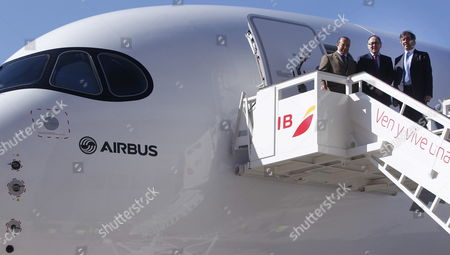 Chairman of Iberia Airlines Luis Gallego (c) Airbus Flight Test Division Vice President Fernando Alonso (r) and the Chairman of International Airlines Group (iag) Antonio Vazquez Romero (c) Outside the New Airbus A359 Xwb Plane After Its Debut at the Adolfo Suarez-barajas Airport in Madrid Spain 19 February 2015 the A350 Xwb Aircraft Landed For First Time at Madrid Barajas Airport From Toulousse (france) in a Demonstration of All Its New Features to the Media and to Iberia Airlines That Currently Has Eight A350-900s on Order at the End of January 2015 the Efficient Medium-capacity Long-range Wide-body Aircraft A350 Xwb Had Won 780 Orders From 40 Customers Worldwide Spain Madrid