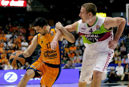 Valencia Basket's Player Rafa Martinez (l) Fights For the Ball with Colton Iverson (r) of De Laboral Kutxa During Their Euroleague Basketball Game Played in Valencia Eastern of Spain on 07 November 2014 Spain Valencia
