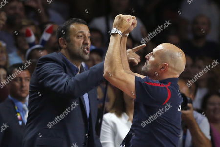 Serbian Coach Sasha Djordjevic (r) Celebrates His Team's Victory Against France As He Stands Next to Former Serbian Basketball Player Vlade Divac (l) After Their Fiba Basketball World Cup Semifinal Match Between Serbia and France at Sports Palace in Madrid Spain 12 September 2014 the Spain 2014 Fiba Basketball World Cup Runs From 30 August to 14 September 2014 Spain Madrid