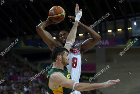 Rudy Gay (back) of the Usa in Action Against Ksistof Lavrinovic of Lithuania During the Fiba Basketball World Cup Semi-final Match Between the Usa and Lithuania at Palau Sant Jordi Sports Pavilion in Barcelona Catalonia North-eastern Spain 11 September 2014 Spain Barcelona