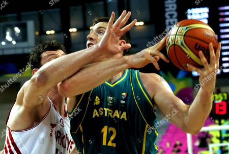 Australia's Aron Baynes (r) in Action Against Turkey's Omer Asik (l) During the Fiba Basketball World Cup Round of 16 Match Between Turkey and Australia at the Palau Sant Jordi Pavilion in Barcelona Northeastern Spain 07 September 2014 Spain Barcelona