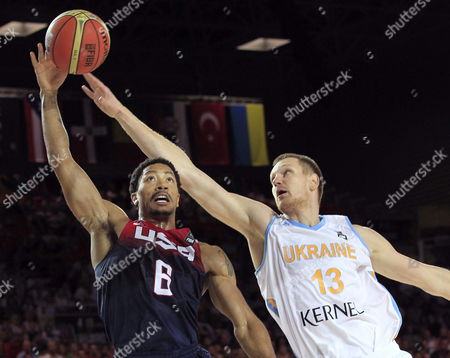 Us Player Derrick Rose (l) Fights For the Ball with Ukraine's Igor Zaytsev During the Fiba Basketball World Cup Match Group C Match Between United States and Ukraine at the Bilbao Exhibition Center in Bilbao Basque Country Northern Spain 04 September 2014 Spain Bilbao