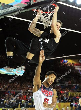 Thomas Abercrombie (up) of New Zealand in Action Against Derrick Rose (bottom) of the Usa During the Fiba Basketball World Cup Match Group C Match Between the Usa and New Zealand at the Bilbao Exhibition Center in Bilbao Northern Spain 02 September 2014 Spain Bilbao