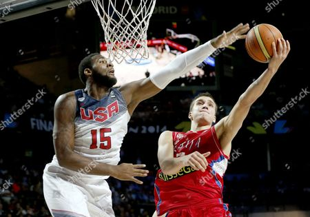 Andre Drummond (l) of the Us in Action Against Bogdan Bogdanovic of Serbia During the Fiba Basketball World Cup Final Match Between the Usa and Serbia in Madrid Central Spain 14 September 2014 Spain Madrid