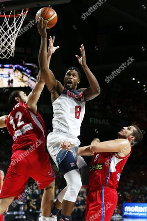 Rudy Gay (c) of the Usa in Action Against Serbian Players Nenad Krstic (l) and Nemanja Bjelica (r) During the Fiba Basketball World Cup Final Match Between the Usa and Serbia in Madrid Central Spain 14 September 2014 Spain Madrid