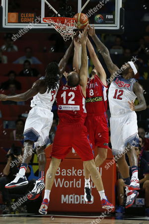 Kenneth Faried (l) and Demarcus Cousins (r) of the Us in Action Against Nenad Krstic (2nd-l) and Nemanja Bjelica (2nd-r) of Serbia During the Fiba Basketball World Cup Final Match Between the Usa and Serbia in Madrid Central Spain 14 September 2014 Spain Madrid